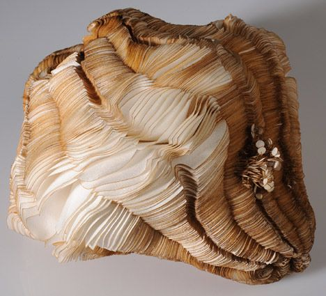 Sivan Royz has designed purses from laser cut silk that resemble fungi and function like living organisms.