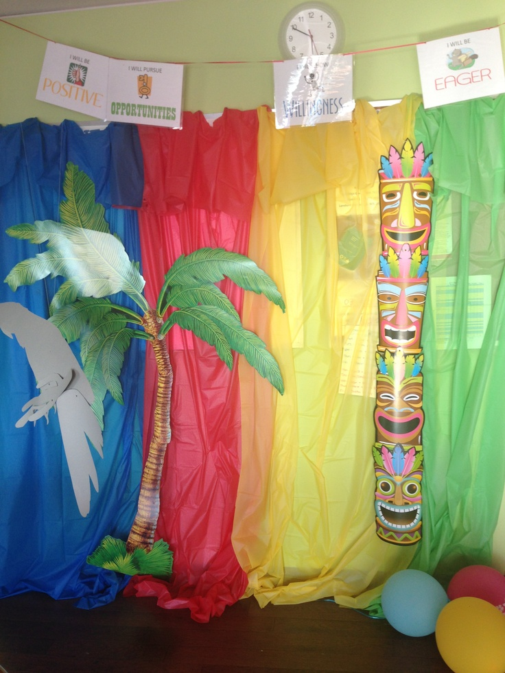 Photo booth for kids party. Hawaiian theme. Use plastic table cloths from the dollar store and cardboard cut puts from dollar store. Super easy and cheap and makes for great pictures.