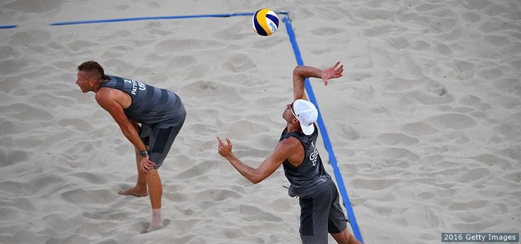 Jake Gibb (R) serves as Casey Patterson looks on at the men's beach volleyball preliminary round Pool F match against Jefferson Santos Pereira and Cherif Younousse Samba of Qatar at the Rio 2016 Olympic Games at the Beach Volleyball Arena on Aug. 6, 2016 in Rio de Janeiro. Gibb and Patterson won 2-0.