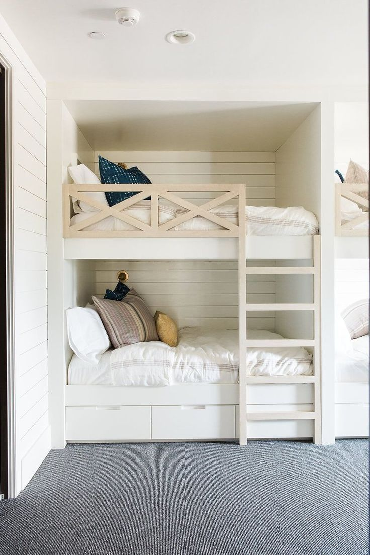 kids bedroom with builtin bunk beds with shiplap walls