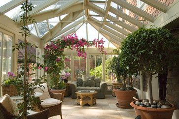 I like this all glass conservatory with large potted plants. Traditional porch by Town and Country Conservatories