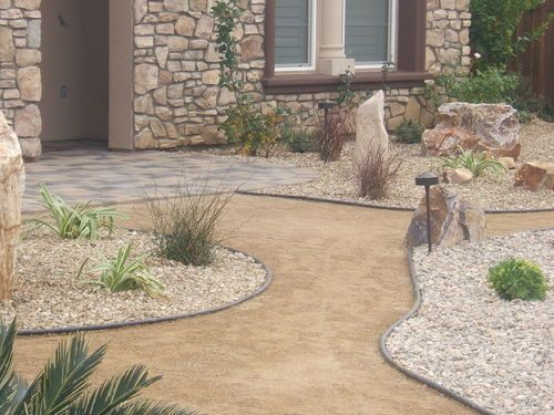 Drought tolerant landscape. Decomposed Granite pathway. Palm Spring rock.