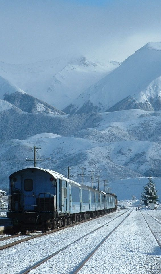 Take a scenic ride on the TranzAlpine Train, from Christchurch to Greymouth, or vice versa, South Island, New Zealand - I did this in springtime, there was still plenty of snow around on the mountains, but lots of green grass - idyllic.