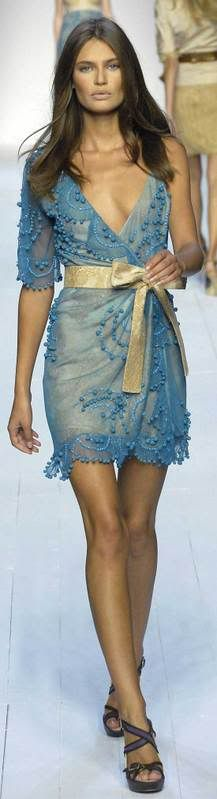 Loving this dress it's gorgeous Blue sheer short  dress detailed with organza stitching  tied up with a gold bow