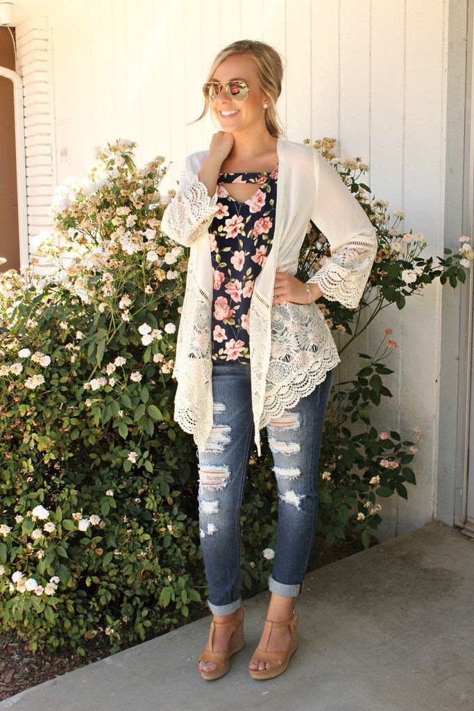 Feel lighter than air with this beautifully styled lace cardigan. Traditional cardigan cut and fit, delicate lace styling on the three-quarter length sleeves and along the hemline front and back. Mali