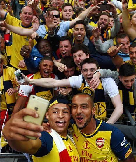Alex Oxlade-Chamberlain and Theo Walcott taking selfie with the Gooners after the FA Cup final 2015. Arsenal 4-0 Aston Villa