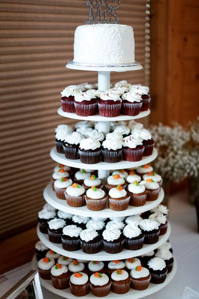 """Wedding cake + cupcake tower idea - six tier cupcake stand filled with red velvet, carrot cake, and chocolate cupcakes + single-tier white-frosted cake + """"Mr. & Mrs."""" silver glitter cake topper {Kate Wenzel Photography}"""