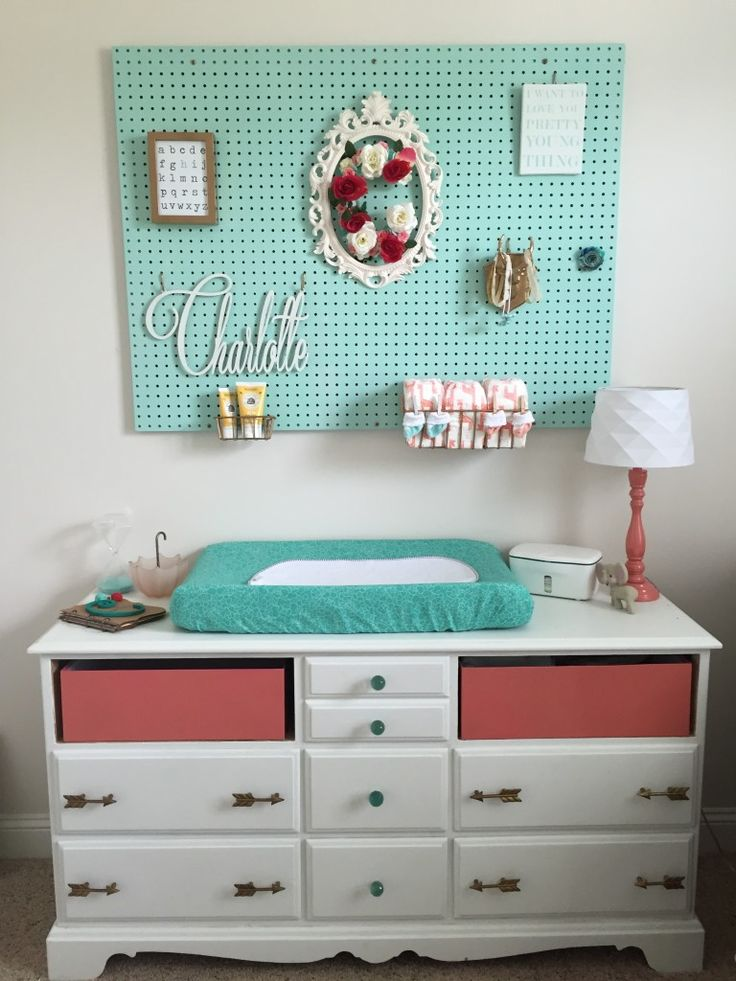 Pegboard over a Changing Table in the Nursery - love the girly touches to this one!