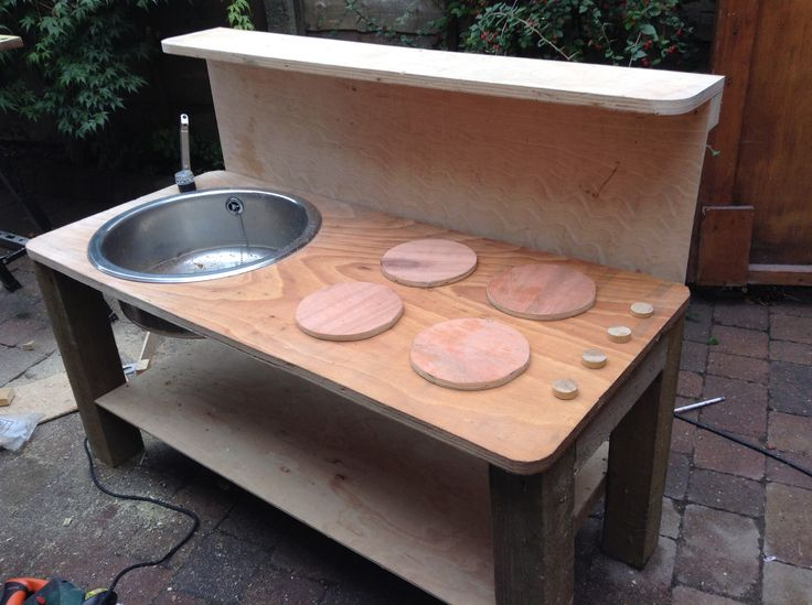 Our new mud kitchen made with scraps of wood, an old sink and a very handy husband.