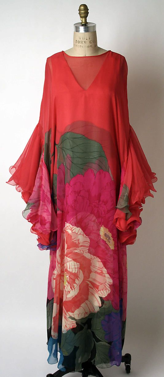 Evening ensemble ~ designed by Japanese designer, Hanae Mori.  This confection consists of a V-neck, silk shift.  The sheer rayon confection is hand dyed with an Asian-inspired floral pattern ~ block colors of raspberry pink, deep forest green, watermelon red, and blueberry.  The long sleeves flare out into a exaggerated ruffled hemline.