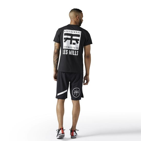 Reebok - LES MILLS BODYCOMBAT Dual Blend Tee: When it comes to your BODYCOMBAT apparel, you need gear that's as tough as you are. This LES MILLS BODYCOMBAT t-shirt is the perfect companion. Built to do battle in the studio, its sleek fit and bold style can easily translate to everyday wear, as well.
