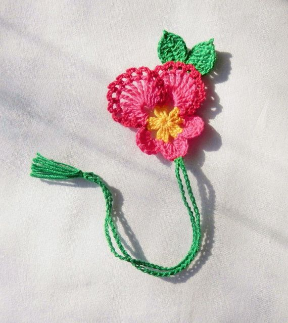 New handmade crocheted gorgeous pink pansy flower bookmark .    About 9 1/2 Long .    This bookmark is a great gift for you Or for your friend.    Made with 100% high quality cotton thread in hot pink and green color.    Please check out my other bookmarks. Thanks.   Comes from smoke free and pet free home.
