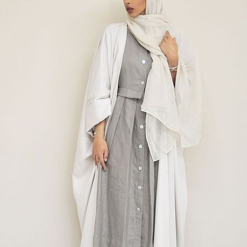 Pinterest: @eighthhorcruxx. Grey abaya with buttons and white cardigan