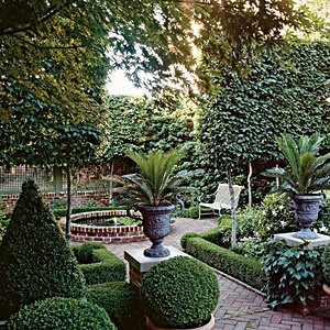 I don't have formal gardens but this appeals to me on every level.  Short boxwood hedges, brick, conical evergreen.