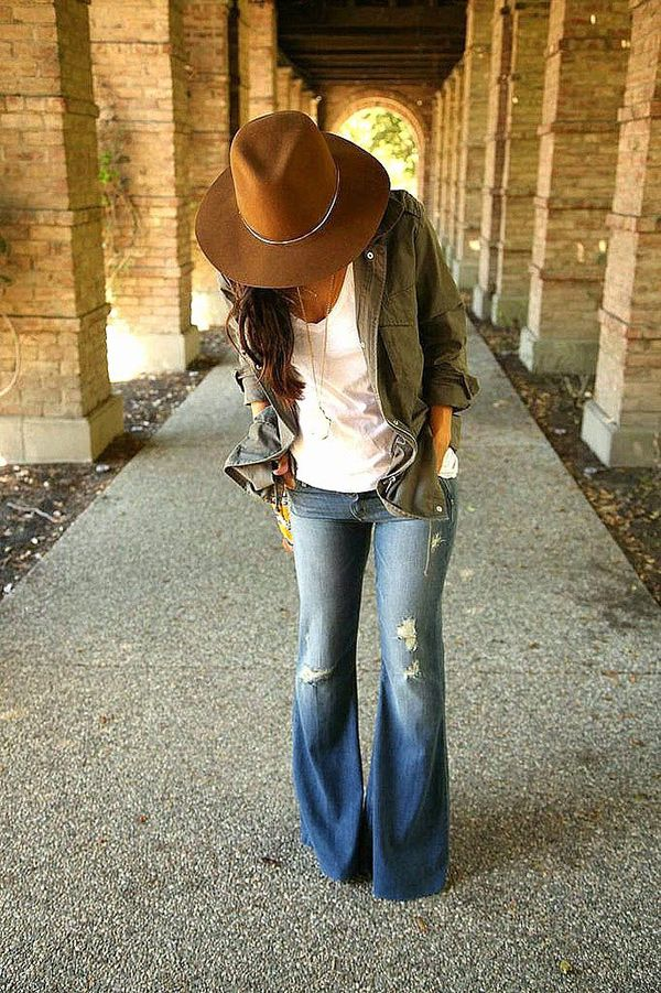 Love these flares with holes, white t, army jacket and floppy hat.