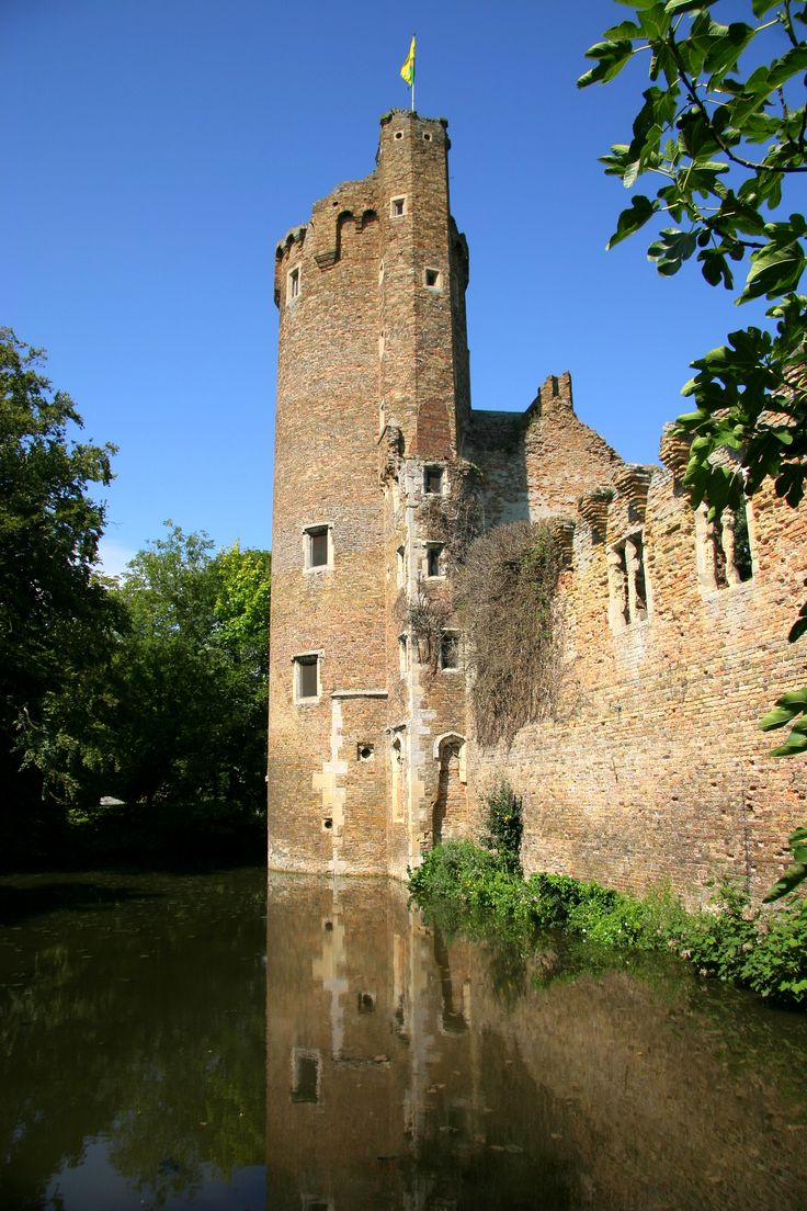 15th century moated Caister Castle, Great Yarmouth, Norfolk, England. Built by Sir John Falsolf, who was the inspiration for Shakespeare's Falstolk