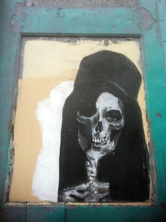 picturing doors   The Amy alleys: A skeletal painting of Amy Winehouse peers out from a boarded-up window...