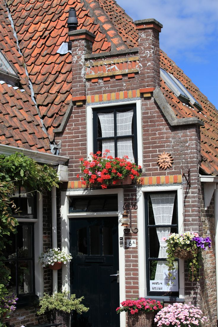 Texel, Noord-Holland. flower window boxes, lace curtains, brick homes