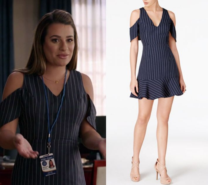 "Valentina Barella (Lea Michele) wears this navy blue striped cold shoulder drop hem dress in this episode of The Mayor, ""The Filibuster"". It is the J.O.A. Cold-Shoulder Fit & Flare Dress."