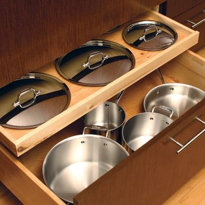 A sliding, shallow drawer inset for lids in a pots & pans drawer - I need one of these, too! So do a few of my clients!