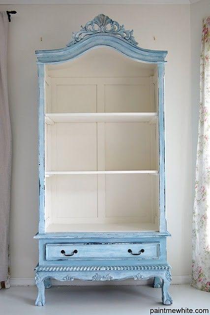 Doors removed, painted blue outside and white shelves inside. BOOKSHELF!!