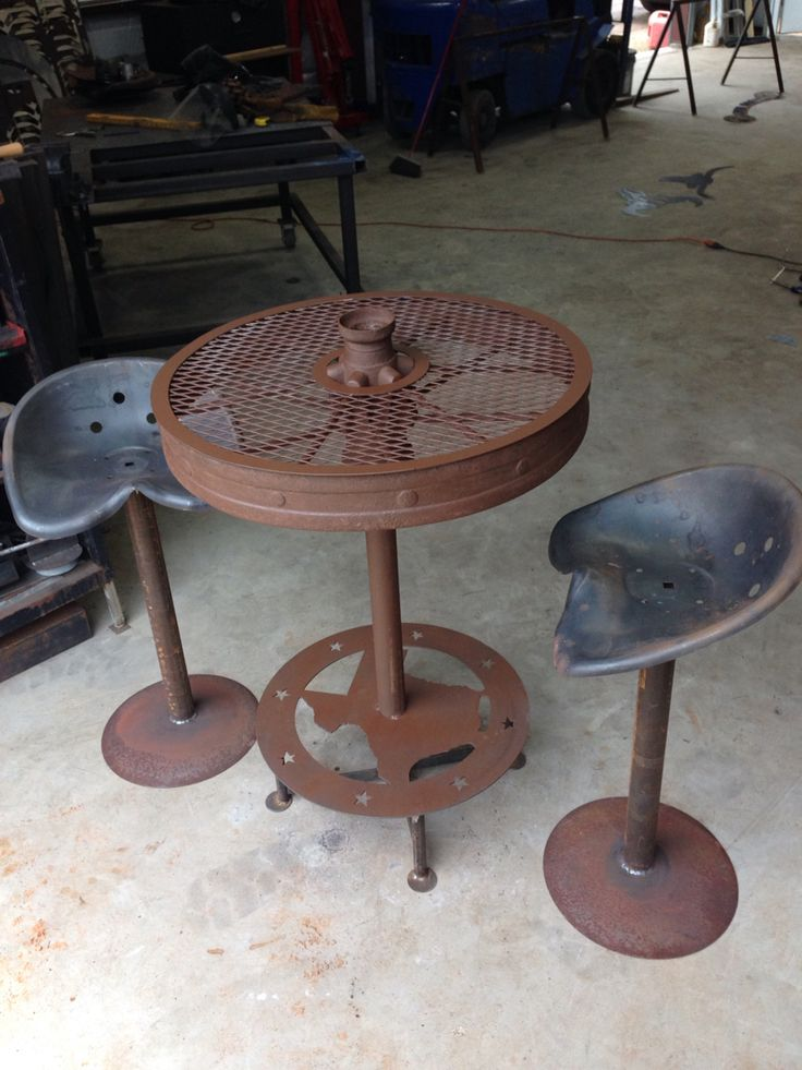 Wagon wheel table with tractor seat stools.