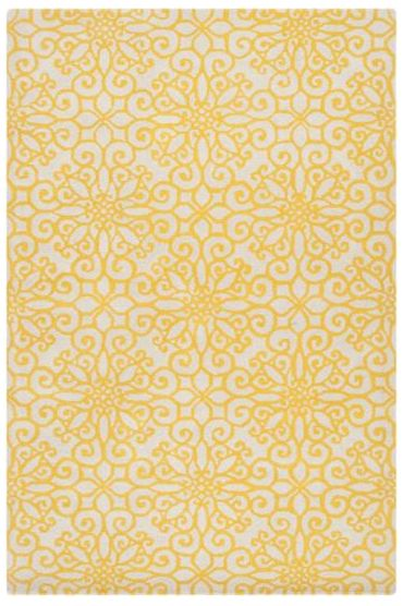 Brighten up your space with a yellow area rug and other citrusy accents, which you can see at Blog.HomeDecorators.com.