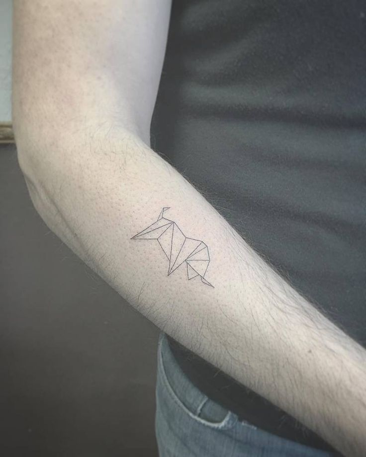 Fine line style polygonal bull tattoo on the right forearm ...