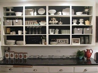 I love this.  My latest idea is to use chalk paint colored like Martha Stewart shows how to do on her site and match my kitchen cabinet color - Meadowlark from Sherwin Williams and then it would flow easily and be seemless; very serene and calming.  I'm in the midst of painting so maybe I'll post pictures.