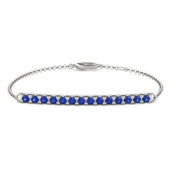 The Linear Bar Bracelet styled in sapphire and white gold.