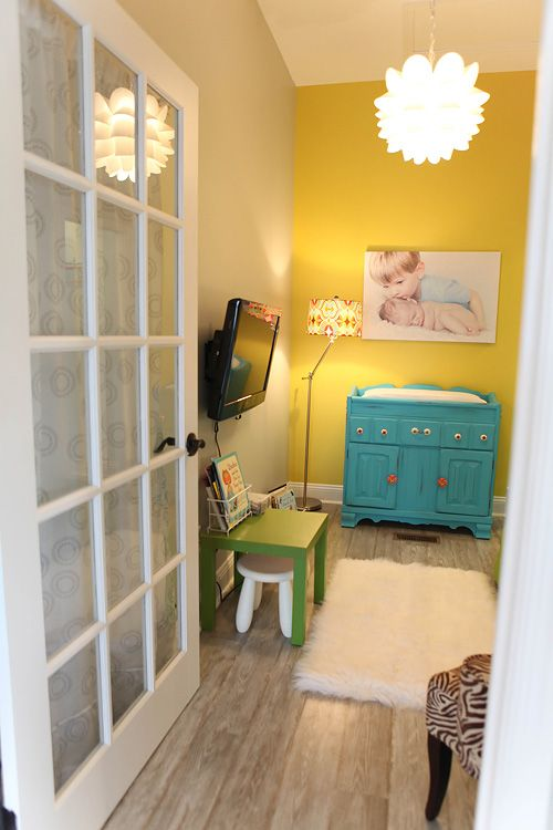 cute waiting space for children and changing area for babies
