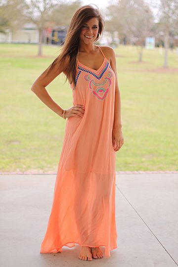 """We love the carefree style of this maxi! The flowy material is very forgiving, and the embroidered design is the perfect detail for this dress. Wear it with or without a belt..either way looks great!!   Fits true to size. Miranda is wearing the small.  This one is lined above the knee.   From the shoulder to the hem:  S-55""""  M-56""""  L-56.5"""""""