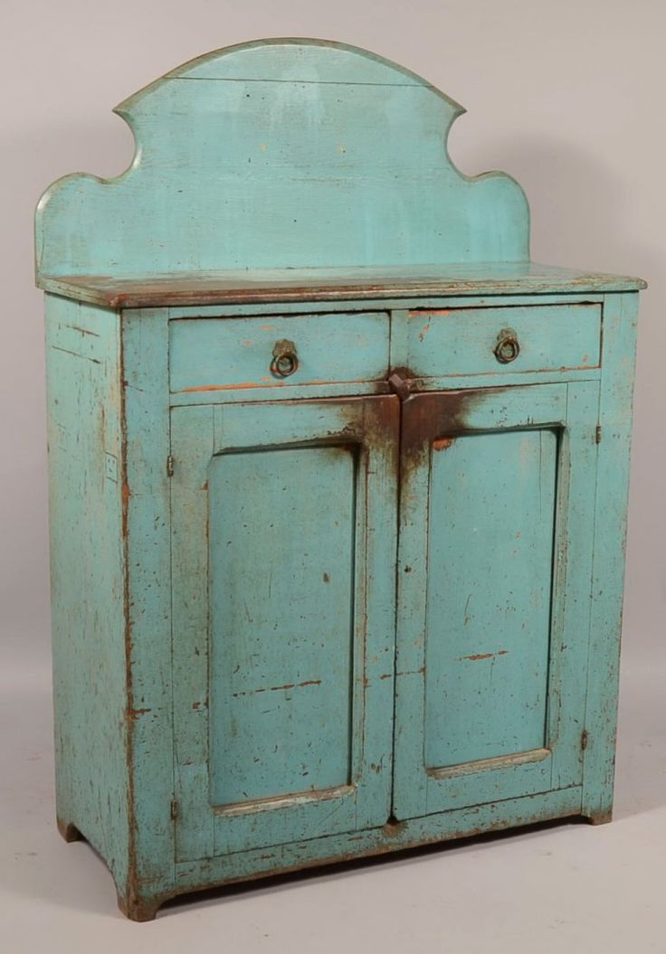 """Pennsylvania Late 19th Century Robin Egg Blue Painted Softwood Jelly Cupboard. Arched splash-back, two split dovetailed drawers above two lower sunken panel doors, interior shelves and arched cut out feet. 65 1/2""""h. x 43 1/2""""w. x 18""""d. Condition: Good with wear and paint loss."""