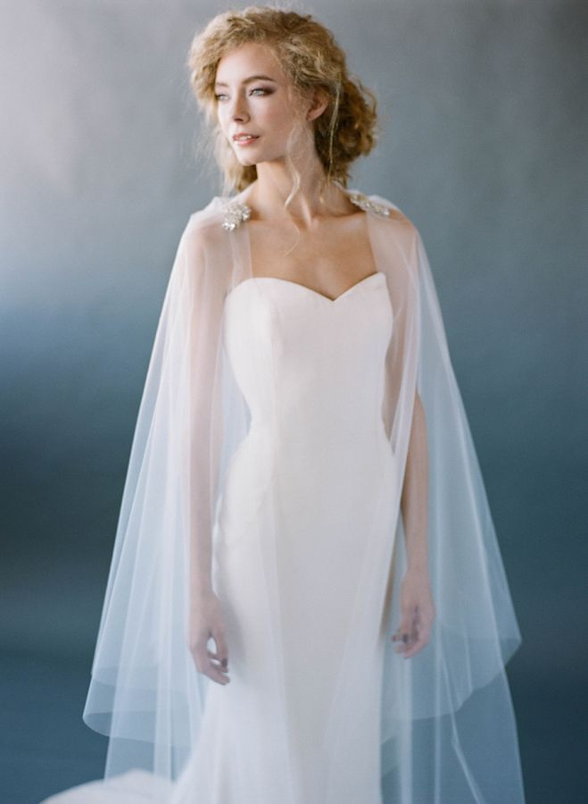 A veil that doubles as a cape by Love Veils: http://www.stylemepretty.com/2015/10/14/behind-the-designer-love-veils/ | Photography: Stacy Bauer - http://www.stacybauerphotography.com/