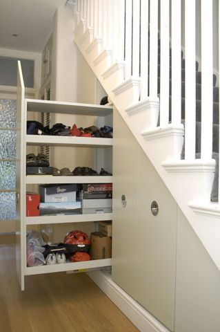 Tall broom cupboard with pull-out under stairs storage