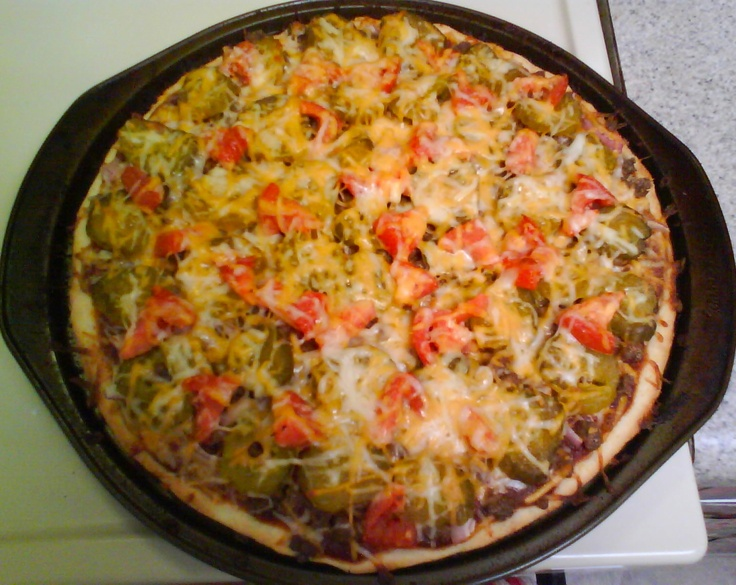 Bacon Cheeseburger Pizza: ground beef, bacon, tomato, onion, pickles