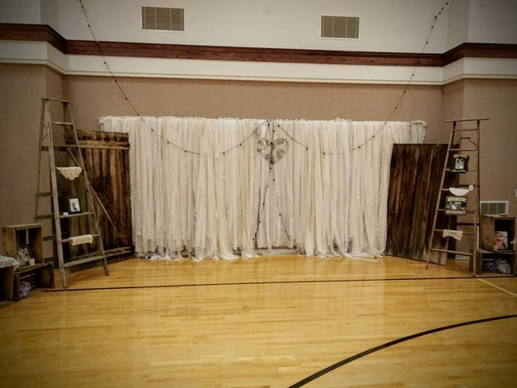 Wedding Receiving Line backdrop.  Rustic 8 ft A-Frame Ladders, lace strip curtains, Barbwire heart, real barn doors and lots of little rustic touches were wonderful.