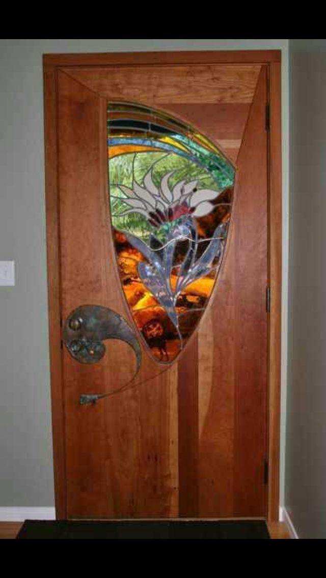 Stained glass in wooden door.