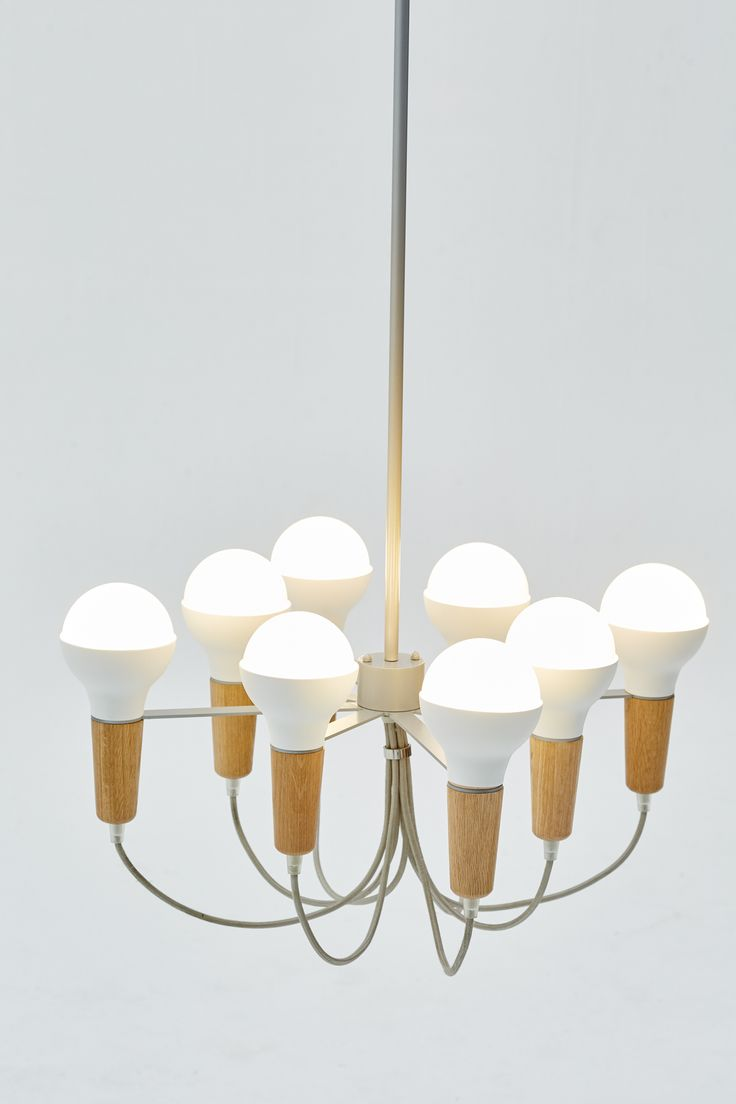 A new twist on a Scoop Pendant comes the Scoop chandelier by Stephanie Ng Design