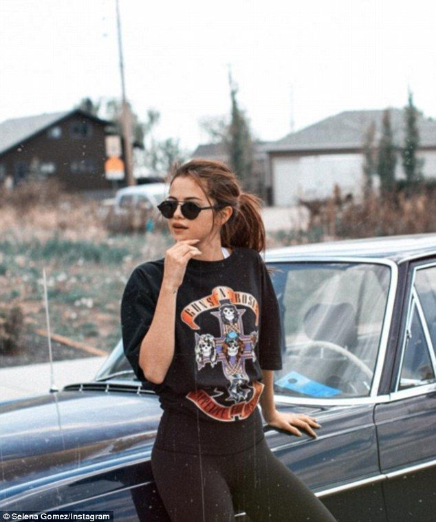 Appetite for construction: Selena wore a Guns 'N' Roses shirt as she stopped near some was...