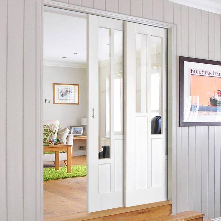 Twin Telescopic Pocket Coventry Style White Primed Doors - Clear Glass.    #pocketdoors #hiddendoors #telescopicdoors moderndoors #lpddoors #interiordesign #moderniinteriordoors