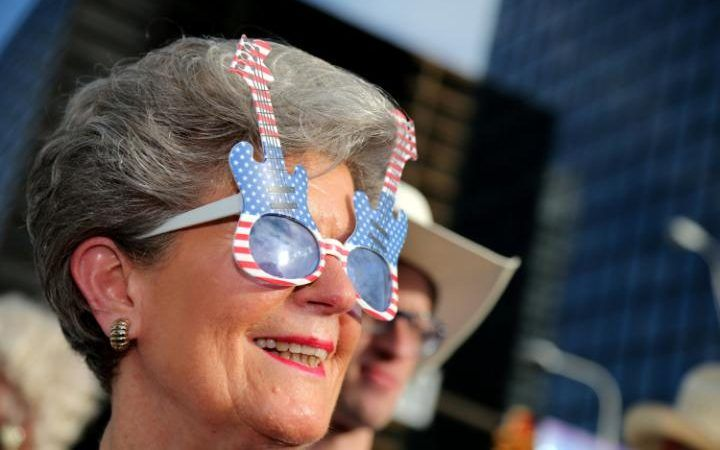 Barbara Hauser, of Texas, looks on as she waits to enter a Rock the Night kick off party on the sidelines of the Republican National Convention in Cleveland, Ohio.