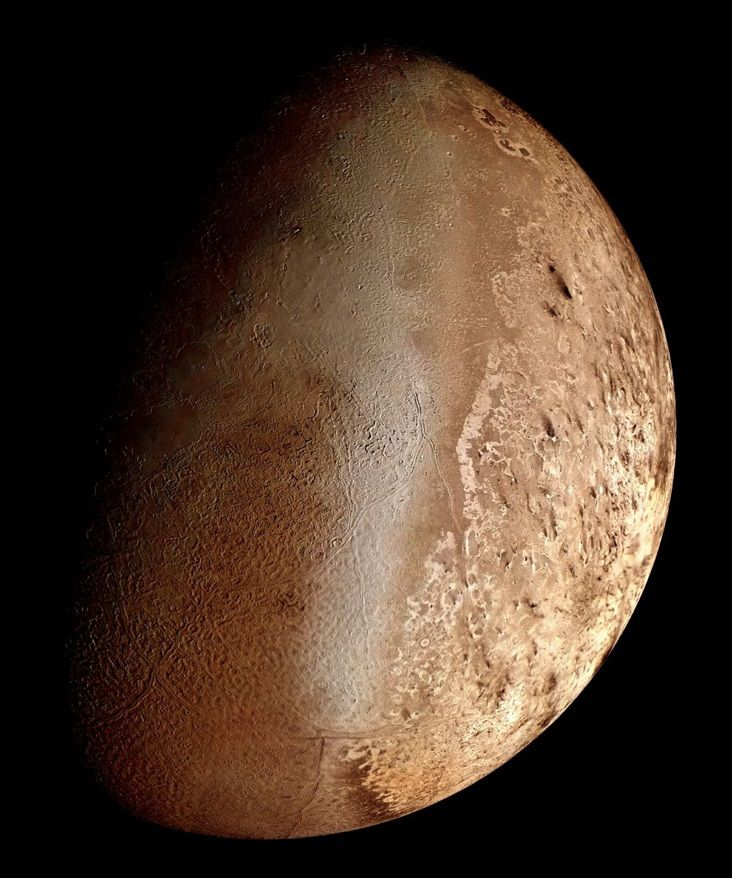 Triton (Voyager 2) [Wikipedia] is the largest natural satellite of the planet Neptune. It is the only large moon in the Solar System with a retrograde orbit, an orbit in the opposite direction to its planet's rotation.