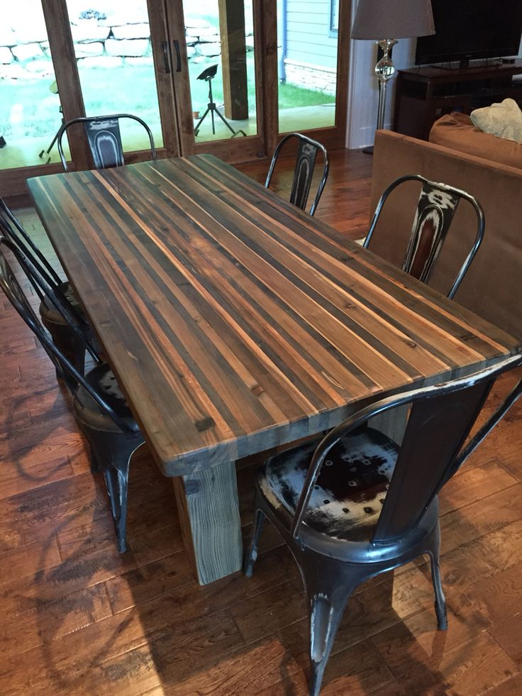 Butcher block style table constructed from various species of cedar and fir. Steel wool and ...