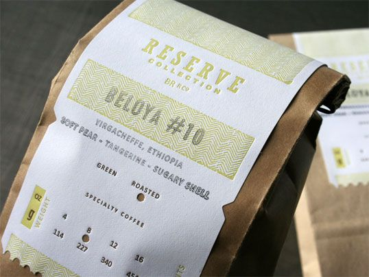 "Designed by Jeff Holmberg | Country: United States ""The label is customized by rubber stamping the coffee variety and hole punching the bean and weight information. The ripped edge of the label on the kraft bag balances a raw yet refined look."""