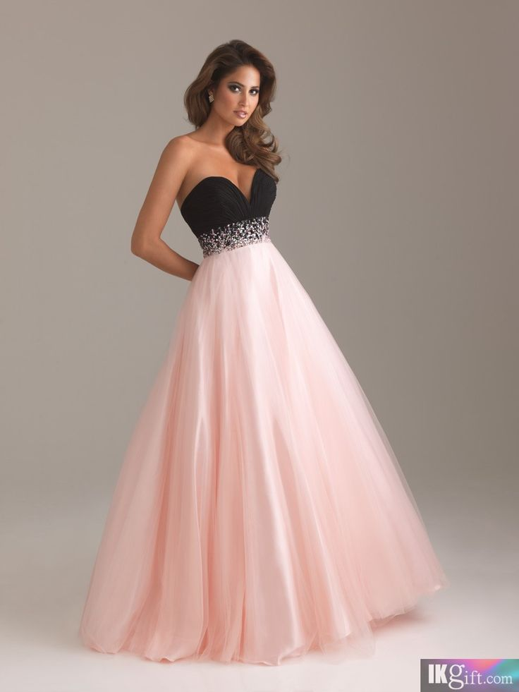 I love this dress. The colors look so good together. Its a strapless dress thqts,again tight at the top and black at the top. While loose and pink at the bottom.
