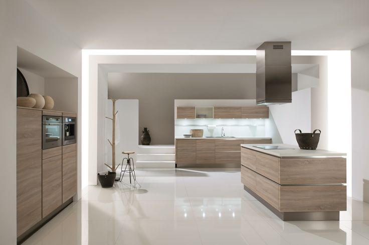 1090 GL | Natural oak rough-cut finish. The perfect ambience for stylish living. Open and clear. In its midst: the handleless island with all round corner moulding. #kitchen #inspiration #modern #contemporary #german #oak #ideas #stunning