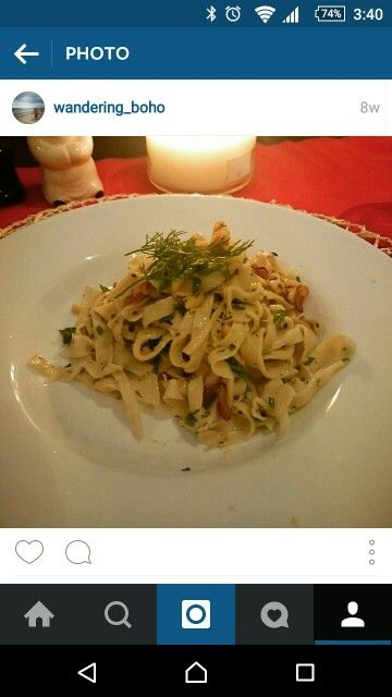 Home made what pasta with butter sauce, caramelized onions and cashew nuts.