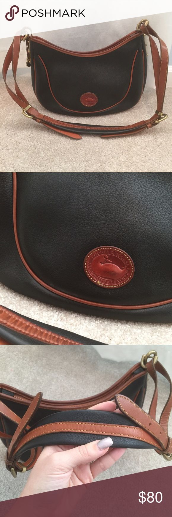 Dooney and Bourke navy purse Authentic navy and tan Dooney and Bourke in good condition with brass details. Suede inside. Dooney & Bourke Bags Shoulder Bags