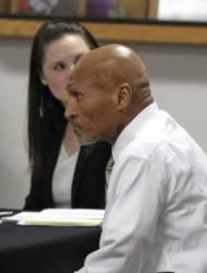 Joseph Sledge appears in court, in Whiteville, N.C., Friday, Jan. 23, 2015, as a three-judge panel convenes to take up his claim of innocence. The panel planned to consider whether Sledge was wrongfully convicted nearly four decades ago of killing a mother and daughter in North Carolina. (AP Photo/The News & Observer, Ethan Hyman)
